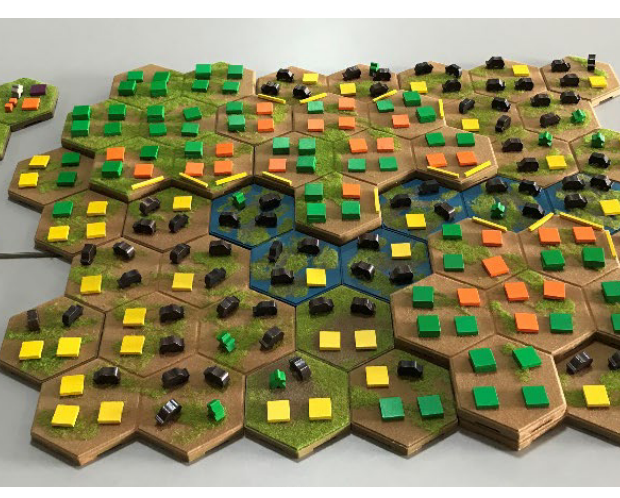 Each grid represents a farm while the landscape is represented with plateau, slopes and riverbanks. Each farm is gridded into four plots on which the farmers make decisions on acitvities that are reprensented by coloured tokens: yellow corresponds to soy, orange to corn, green to forest and the black token to beef.